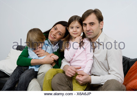 Portrait of a family of four - Stock Photo