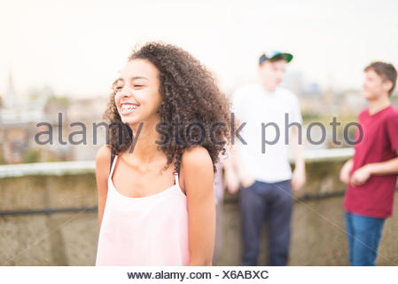 Young woman laughing - Stock Photo