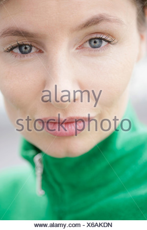 Close-up, woman wearing a green jacket - Stock Photo