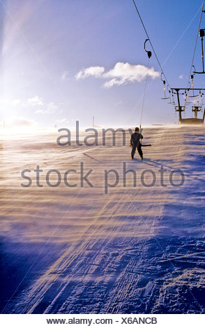 Rear view of a person taking a skilift in Sweden - Stock Photo
