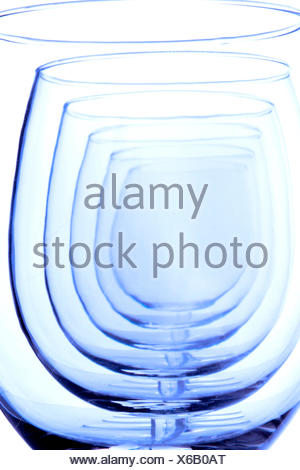 view through a perfectly aligned row of empty wine glasses - Stock Photo