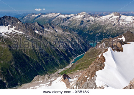 View from Hochfeiler mountain, Pfitschertal valley, Zillertal valley and Schlegeisspeicher dam at the back - Stock Photo