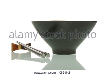 Asia bowl beside chopsticks - Stock Photo