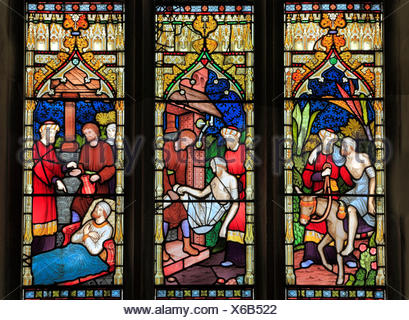 Parable of The Good Samaritan, stained glass by Frederick Preedy, 1865, Gunthorpe, Norfolk, England, UK, Good Samaritan takes injured traveller - Stock Photo