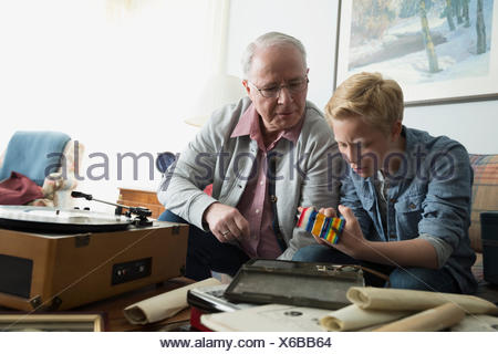 Grandfather showing grandson old war medals - Stock Photo