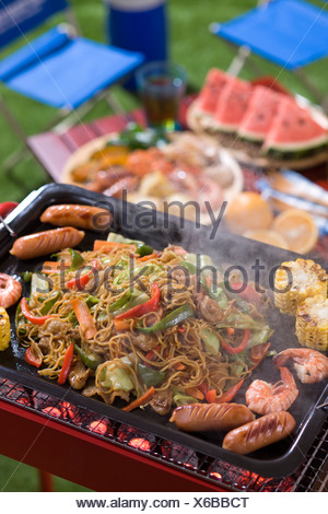 Fried Noodle Cooked on Barbecue Grill - Stock Photo