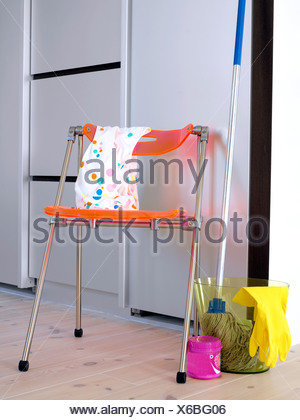 A chair and cleaning things. - Stock Photo