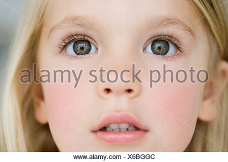 young girl looking dazzled - Stock Photo
