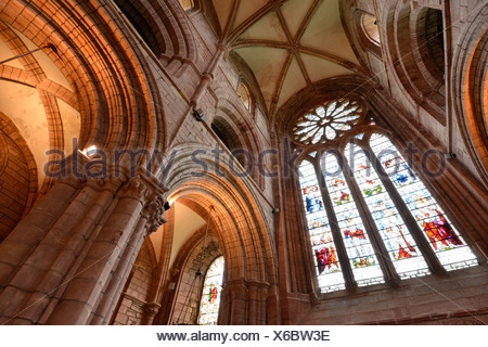 Interior view, large window with a glass mosaic, church window, and ceiling of St. Magnus Cathedral, Orkney Islands, Kirkwall - Stock Photo