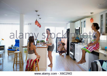 Family in bathing suits at kitchen island stock photo 125214675 alamy family in bathing suits in kitchen stock photo workwithnaturefo