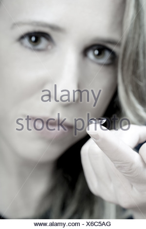 young woman with soft adherent lens - Stock Photo