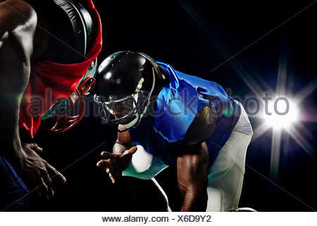 Close up of two american footballers playing head to head - Stock Photo