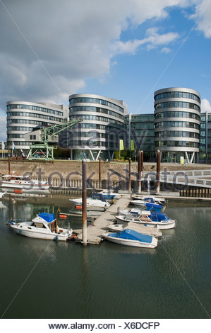 Leisure craft on a wharf, Duisburg Inner Harbour Marina, in front of the Five Boats office complex, North Rhine-Westphalia - Stock Photo