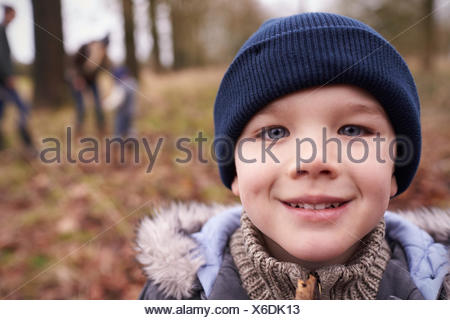 Portrait Of Young Boy On Family Winter Walk In Countryside - Stock Photo