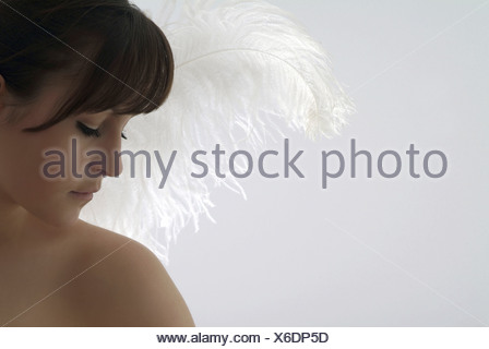 Young woman with angels wings - Stock Photo