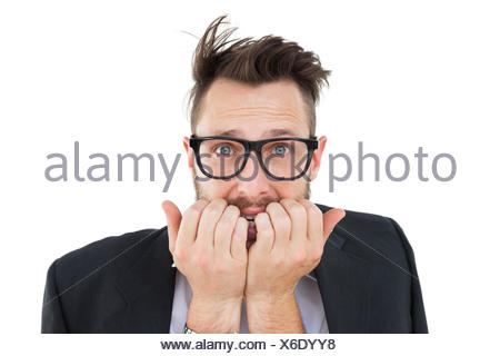 Geeky nervous businessman looking at camera - Stock Photo