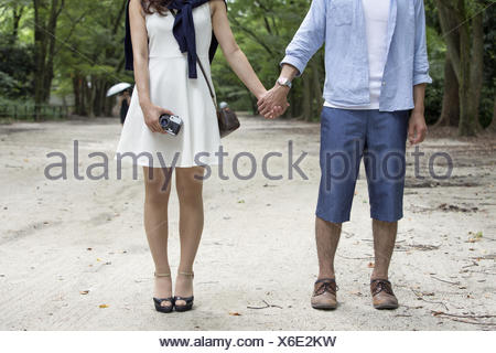 A couple, a man and woman in a Kyoto park. - Stock Photo