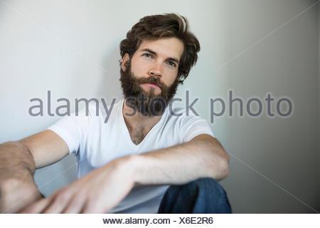 Portrait brunette bearded man - Stock Photo