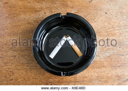 Broken cigarette in an ashtray - Stock Photo