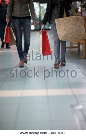 A low angle view of two women walking through a mall, Pietermaritzburg, KwaZulu-Natal, South Africa - Stock Photo