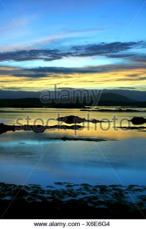 Sunset on a lake - Stock Photo