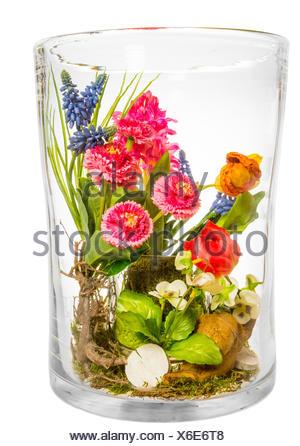 glass chalice tumbler cup arrangement isolated closeup flower plant bloom blossom flourish flourishing flowers tulips spring - Stock Photo
