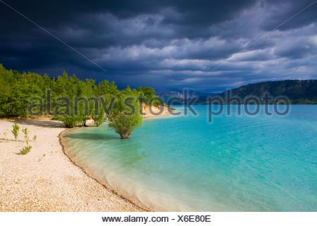 Lac de Sainte Croix, France, Europe, Provence, Alpes-de-Haute-Provence, lake, sea, reservoir, shore, trees, clouds, thunderstorm - Stock Photo