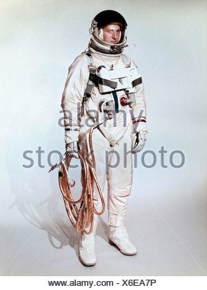 Extravehicular space suite worn Gemini 4 astronaut is shown on test subject.  Gold coated umbilical connects astronaut Gemini - Stock Photo