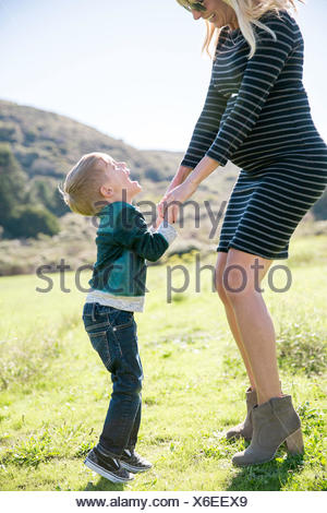 Mother and son enjoying day outdoors - Stock Photo