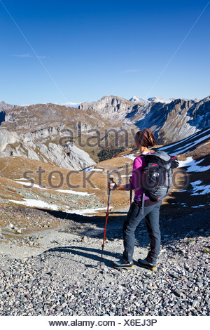 Hiker at the Bervagabunden-Huette hut, on the ascent to the Bepi Zac climbing trail in the San Pellegrino valley above the San - Stock Photo