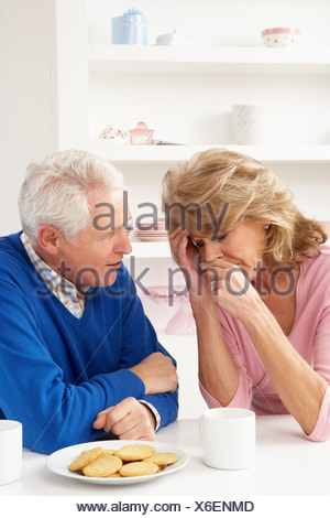 Senior Man Consoling Wife - Stock Photo