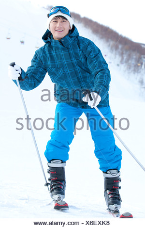 Young man in skiing resort - Stock Photo
