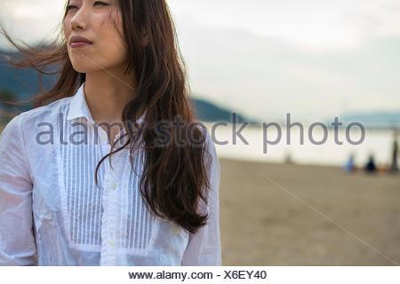 A woman on a beach in Kobe. - Stock Photo