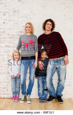 Studio portrait of couple with son and daughter - Stock Photo