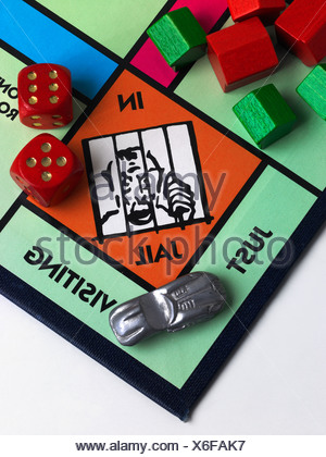 A Monopoly game board showing Jail - Stock Photo