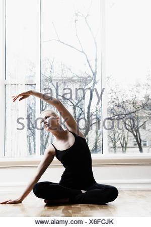 Teenage girl doing yoga exercise - Stock Photo