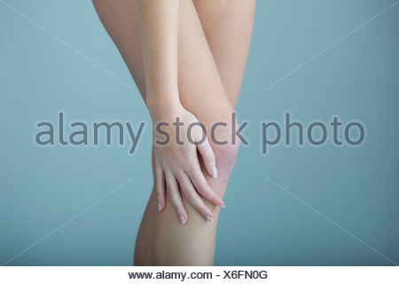 KNEE PAIN  IN A WOMAN - Stock Photo