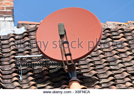 satellite dish on a house roof - Stock Photo