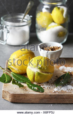 Preparing preserved lemons - Stock Photo