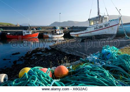 Purteen Harbour, Achill Island, Co Mayo, Ireland; Fishing Boats With Nets And Buoys In Foreground - Stock Photo