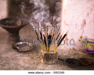 Burning incense, Aravalli Hills of Rajasthan, India - Stock Photo