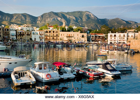 Evening mood at the fishing port of Kyrenia, also known as Girne, Northern Cyprus, Cyprus, Europe - Stock Photo