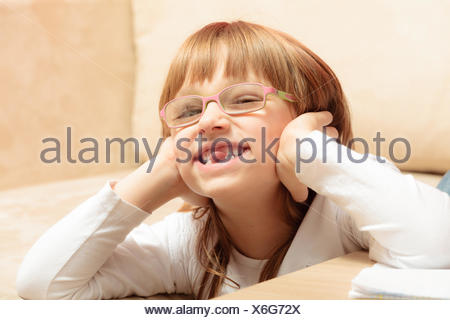 Closeup child missing her top front tooth - Stock Photo