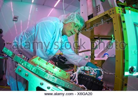 Martin Leahy performs voltage and continuity tests on a tactical satellite, or TacSat-3, at the Air Force Research Laboratory - Stock Photo