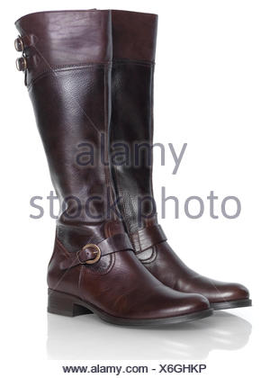 Pair of knee-high brown leather lady's boots - Stock Photo