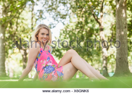 Gorgeous young woman posing on a lawn - Stock Photo