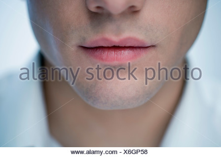 Young man's mouth, close-up - Stock Photo