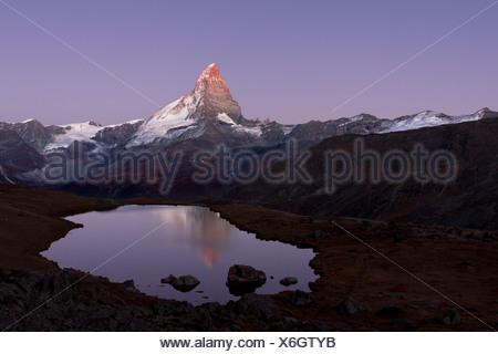 Mt Matterhorn is reflected in Stellisee Lake before sunset, Zermatt, Canton Valais, Switzerland, Europe, PublicGround - Stock Photo