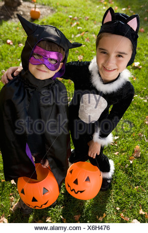 Boy and girl in Halloween costumes - Stock Photo