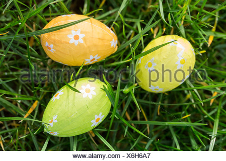 Three easter eggs wrapped in foil - Stock Photo
